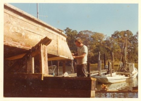 EmaBee's grandfather John working on the Hoopers Island duck-tail boat on the railway in about 1977 with the Razor in the background.