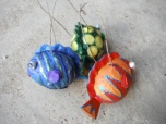 family picture of all three papier mache fish
