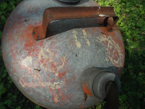 Hidee's old metal gas can - he pained a picture of himself on it with a beard, and a skull and cross-bones.