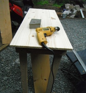 I used the base of a table my dad put together from scrap wood, then I went to the store and got a large board to serve as the work surface.