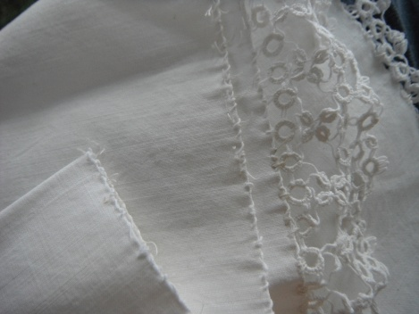 the piece of cloth and lace - notice the incredibly tiny stitches to fasten the lace the the fabric, and to make the lace itself....
