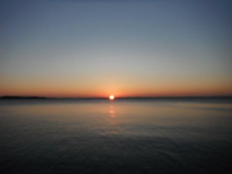 october morning sun cresting the horizon