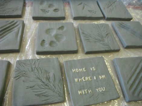 tiles imprinted with pasta, tree branches, and shells