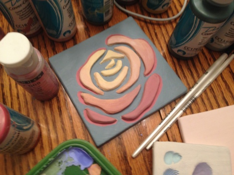 blended under-glazes on the rose, before top coat of glassy finish glaze is applied