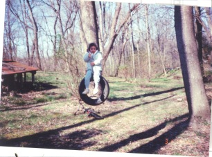 tire swing up in the woods on the hill